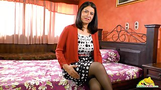 Latin mature woman Anabella is carrying-on with her favorite sex toy